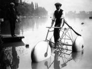 Cyclist in a race over lake Enghien France